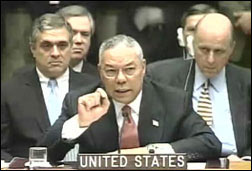 Colin Powell (foreground), lying to the United Nations about Iraq, February 5, 2003. White House photo.